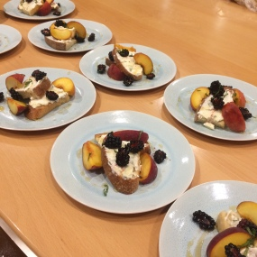 goat's cheese bruschetta with peaches, blackberries and basil infused honey